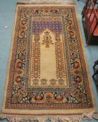 An Eastern prayer rug, 170cm x 98cm Provenance: The Late Dr Helen. E. C. Cargill Thompson