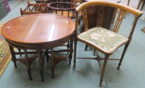 A circular mahogany table with four nesting tables, 49cm high x 76cm diameter and a corner chair (2)