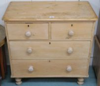 A pine two over two chest of drawers, 83cm high x 85cm wide x 46cm deep Condition Report:
