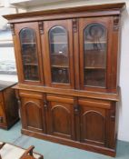 A Reproduction hardwood bookcase with three glazed doors over a base with three drawers over three
