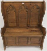 A pine hall bench with panel back and lidded seat, 114cm high x 96cm wide x 46cm deep Condition