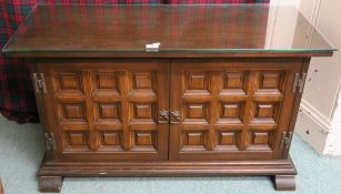 A Younger Toledo oak panelled cabinet with two doors,60cm high x 103cm wide x 40cm deep Condition
