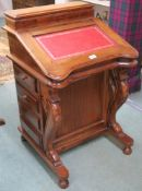A reproduction Davenport with red leather skiver, 85cm high x 55cm wide x 55cm deep Condition