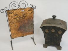 A wrought iron and copper finish Arts and Crafts firescreen, 77cm high x 52cm wide and an Arts and
