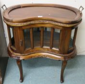A reproduction hardwood kidney shaped drinks cabinet with serving tray, 82cm high x 75cm wide x 45cm
