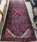 A rich blue ground full pile Persian Soroka runner with central medallion, 300cm x 117cm Condition