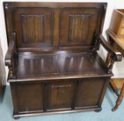 An oak linen fold monks bench, 106cm high x 101cm wide x 54cm deep Condition Report: