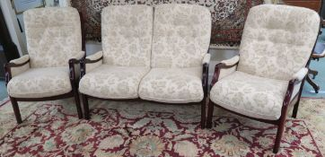 A modern cream upholstered three piece suite comprising sofa and two chairs (3)