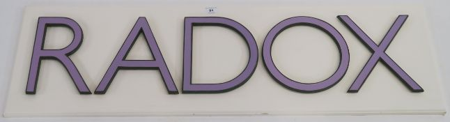 """A """"RADOX"""" metal and lilac enamel sign on white board, 34cm high x 112cm wide (letters 23cm high)"""