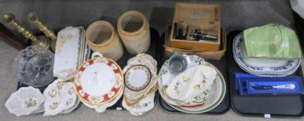 An assortment of sandwich plates, tureens, pair of brass candlesticks, Milbro microscope, etc