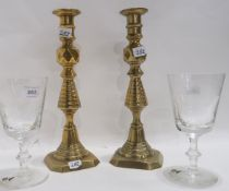 A pair of brass candlesticks and a pair of glass goblet produced for the Design Centre to
