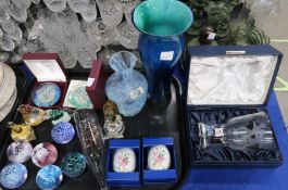 A collection of Caithness glass including a tall blue vase, paperweights and other items Provenance: