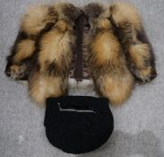 A fox fur shrug, a sheepskin muff etc Condition Report: Not available for this lot