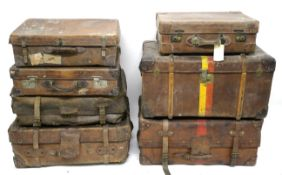 VINTAGE LEATHER LUGGAGE four late 19th century leather cabin trunks in sizes and three Edwardian