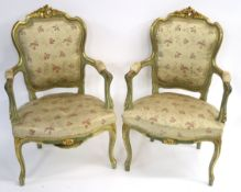 A PAIR OF LOUIS XV STYLE GILTWOOD AND PAINTED FAUTEUIL with carved foliate cresting and padded