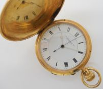 AN 18CT GOLD FULL HUNTER POCKET WATCH with white enamel dial, black roman numerals, silver