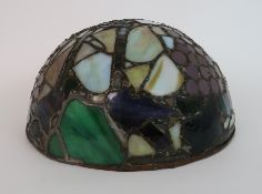 AN EARLY 20TH CENTURY STAINED AND LEADED GLASS PLAFONNIER of circular domed shape, decorated with