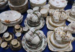 A Tuscan china teaset, a Cauldon teaset with trellis and flower decoration, twenty four hand painted
