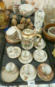 A lot comprising a selection of Japanese eggshell Kutani coloured teawares including cups and