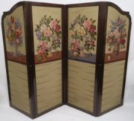 A 20TH CENTURY MAHOGANY FOUR FOLD SCREEN, with wool work panels of flowers in vases, each panel