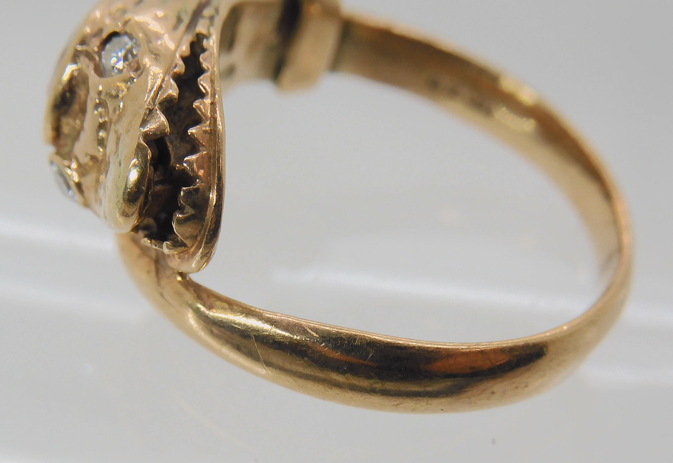 A 9CT ROSE GOLD GARNET AND DIAMOND SNAKE RING finger size J, weight 4.5gms Condition Report: Has - Image 4 of 8