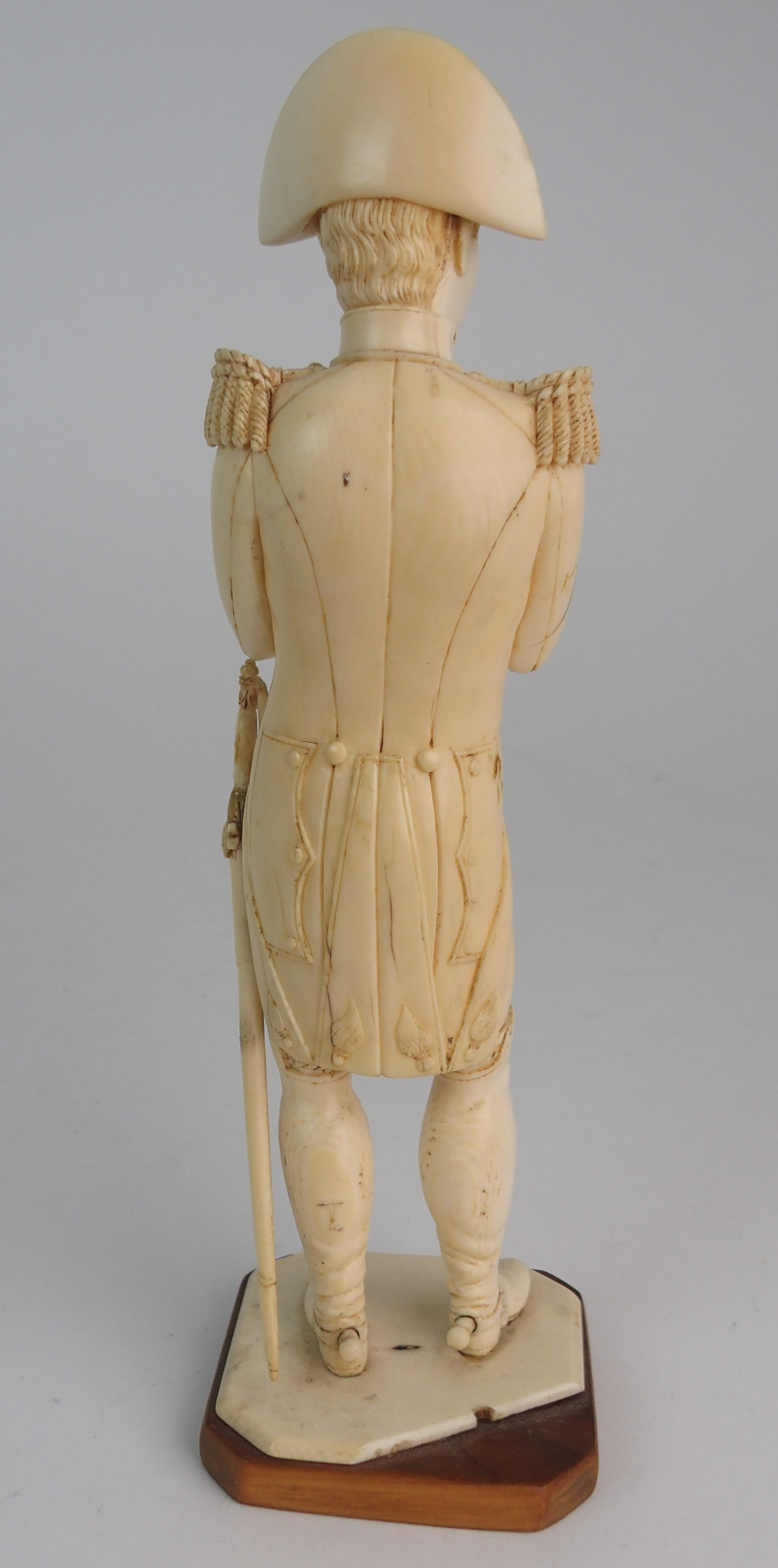 A LATE 19TH/EARLY 20TH CENTURY CARVED IVORY MODEL OF NAPOLEON in uniform with crossed arms, on - Image 6 of 9