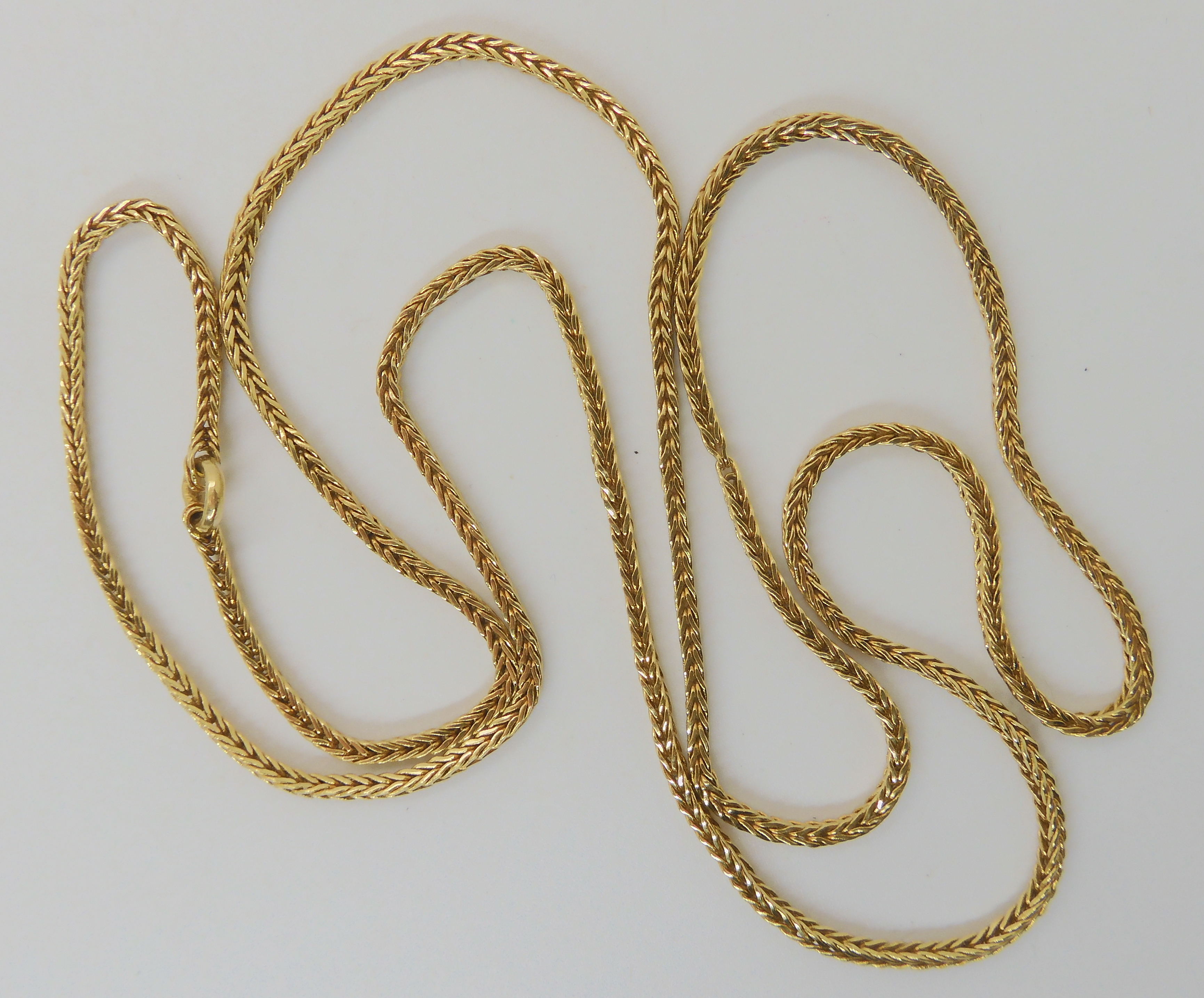 A BRIGHT YELLOW METAL HERRINGBONE CHAIN chain has no clasp, length approx 63cm, weight 18gms