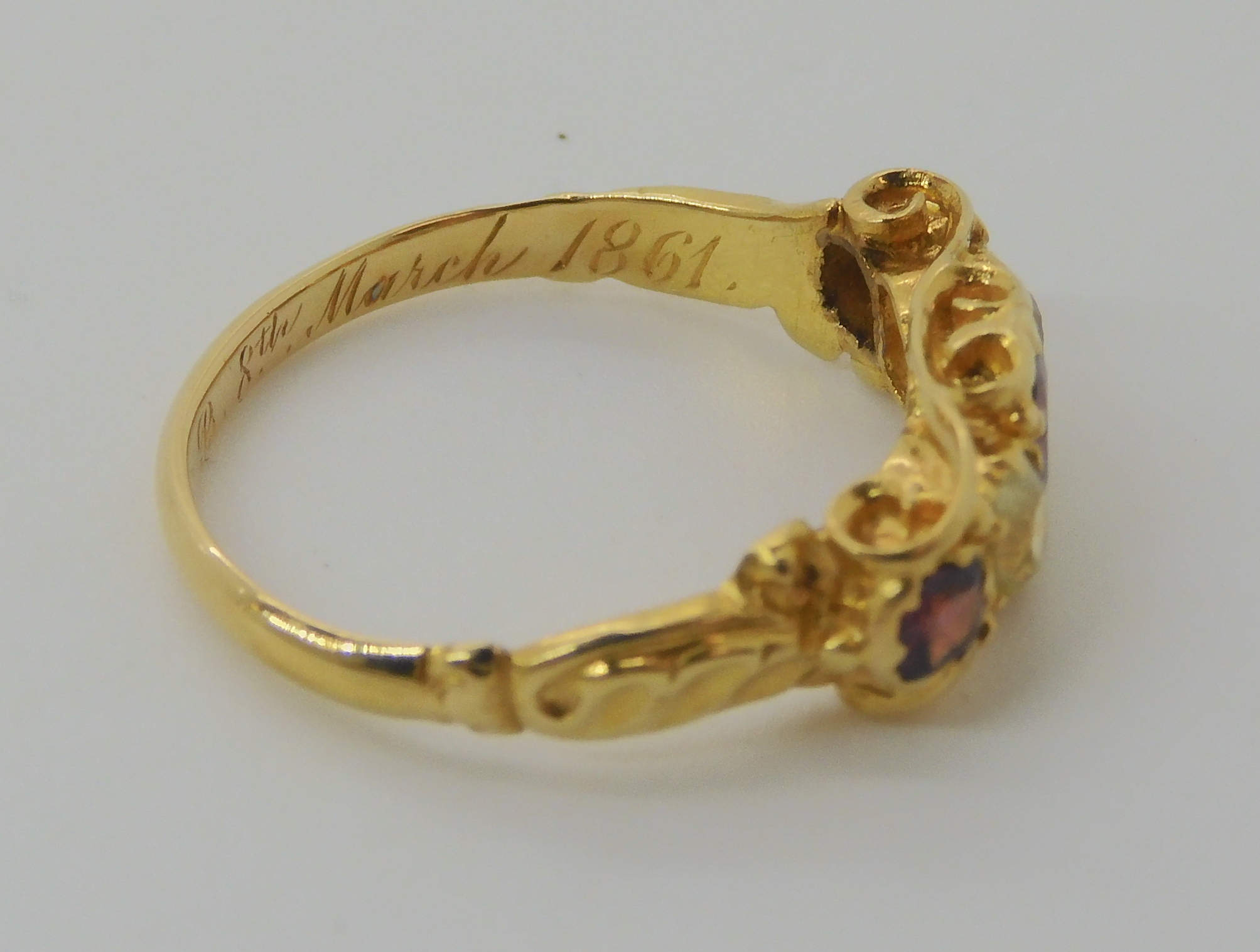 A VICTORIAN GEM SET RING inscribed and dated 1861, set with garnets and pale green gems, finger size - Image 7 of 7