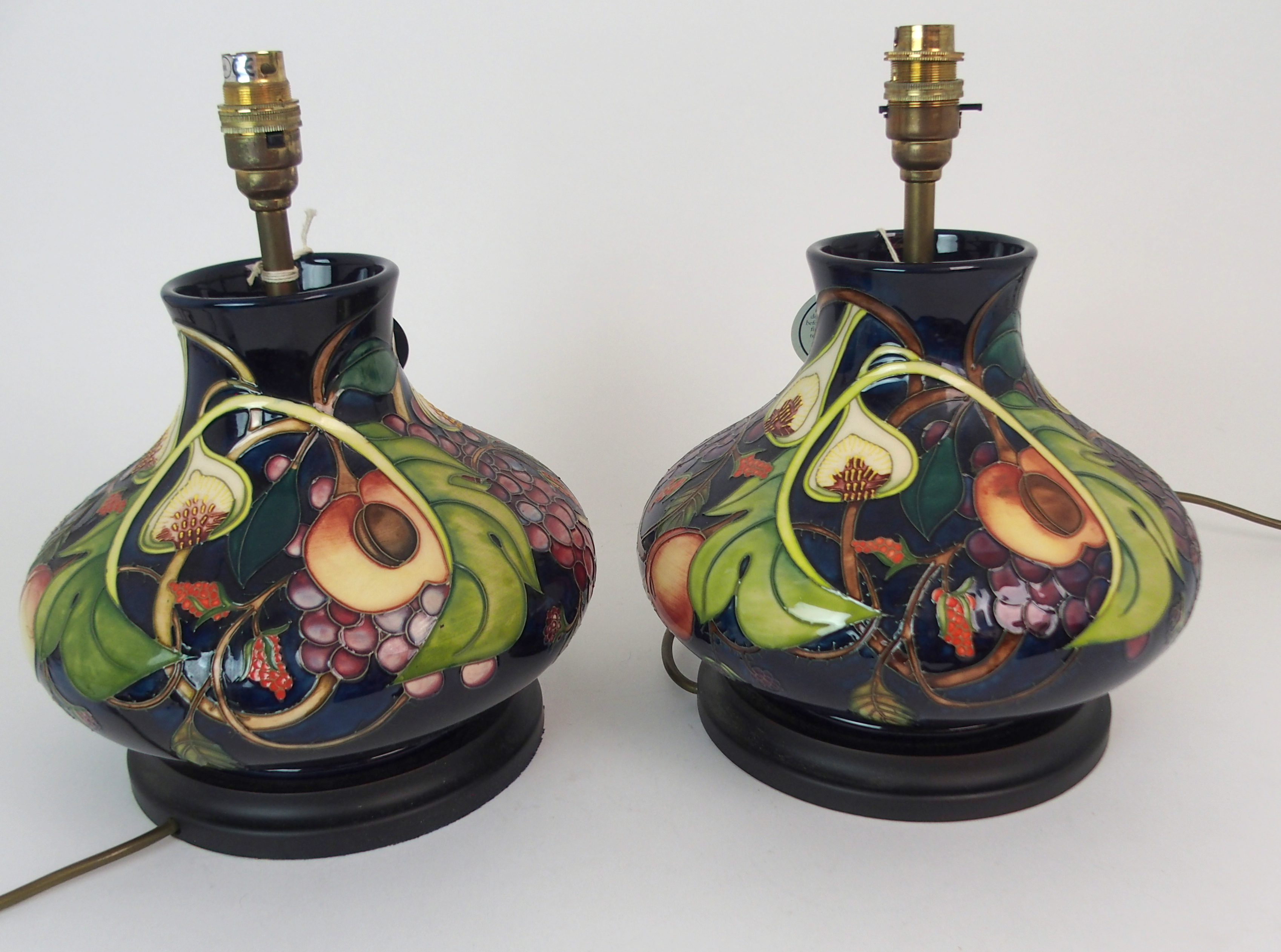 A PAIR OF MOORCROFT QUEENS CHOICE TABLE LAMPS of squat bulbous form, 31cm high Condition Report: