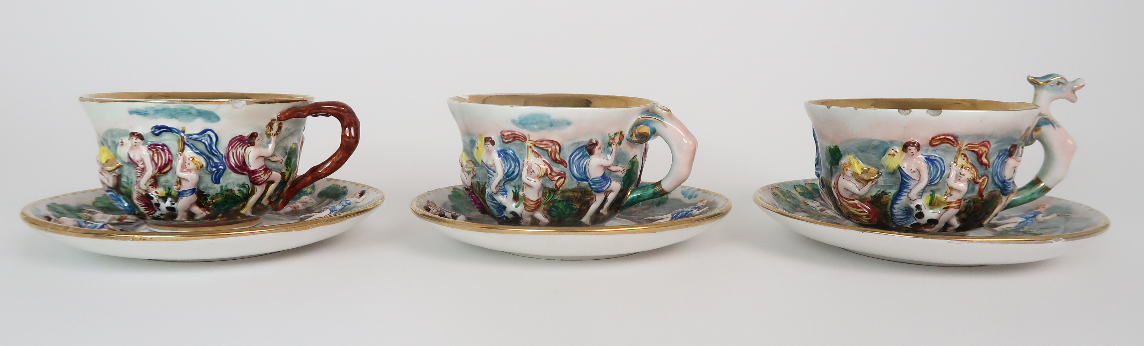 THREE CAPODIMONTE CUPS AND SAUCERS decorated with bacchanalian scenes, a pair of Sevres pots - Image 2 of 16
