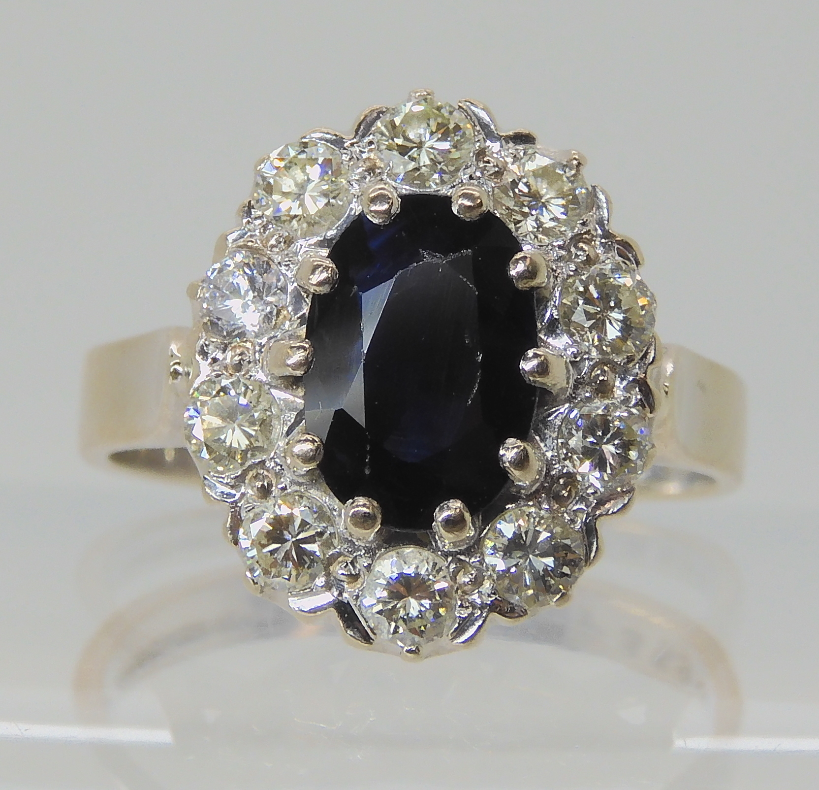 AN 18CT WHITE GOLD SAPPHIRE AND DIAMOND CLUSTER RING set with estimated approx 0.50cts of - Image 4 of 8