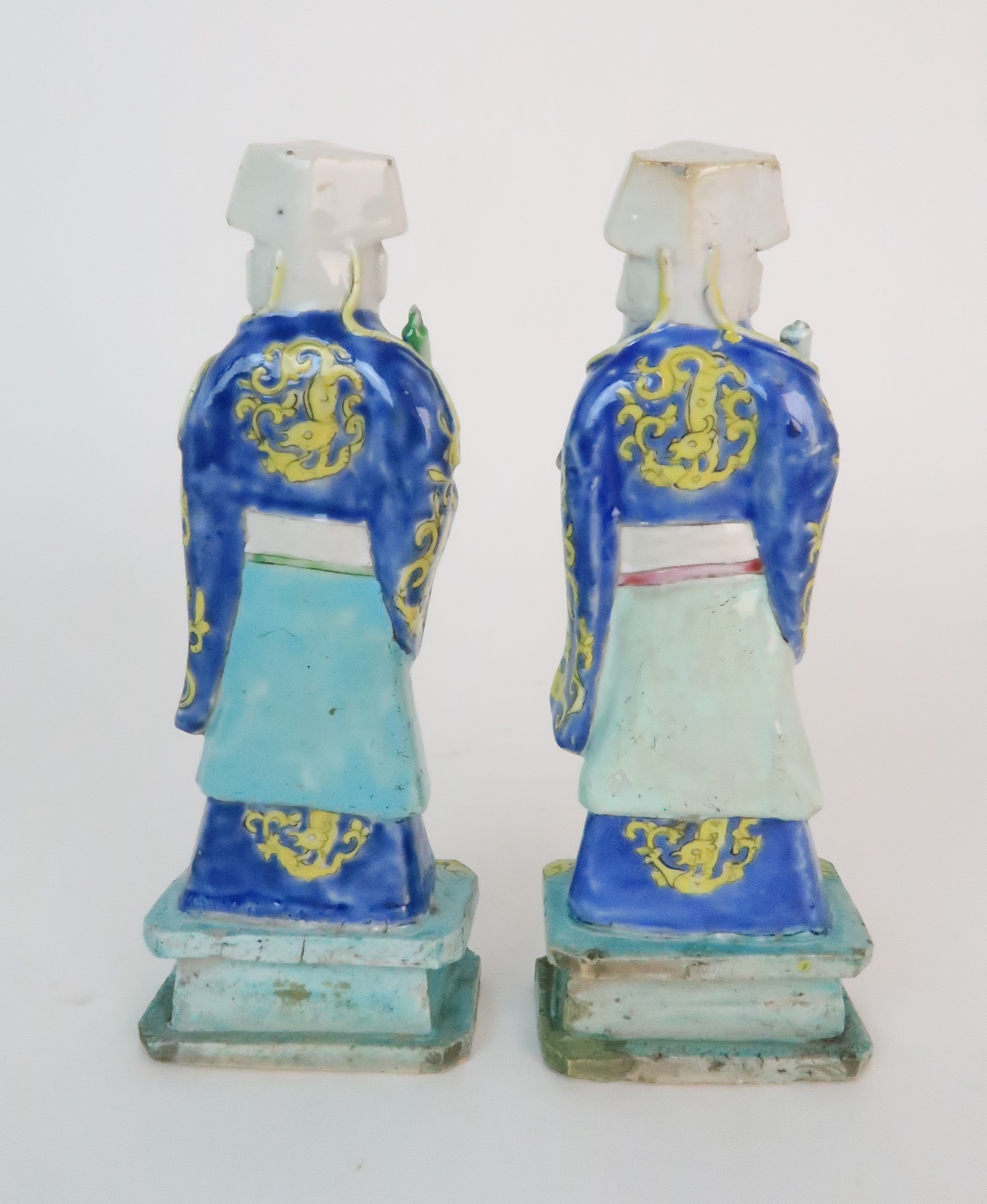 A PAIR OF CHINESE EXPORT MODELS OF OFFICIALS each standing and holding a scroll, diaper aprons and - Image 3 of 9