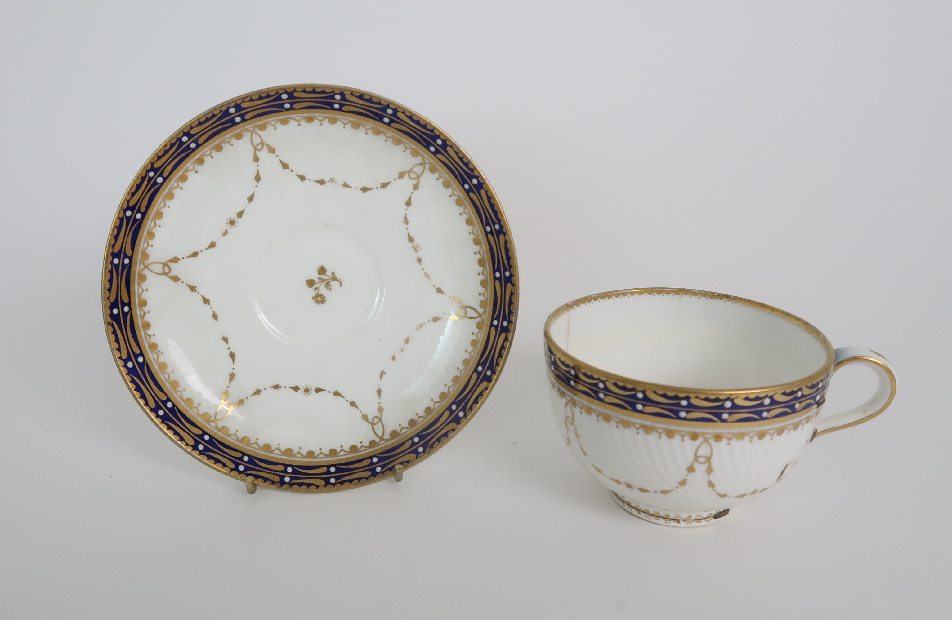 A COLLECTION OF 19TH CENTURY ENGLISH BLUE AND GILT DECORATED TEA AND COFFEE WARES including a - Image 17 of 23