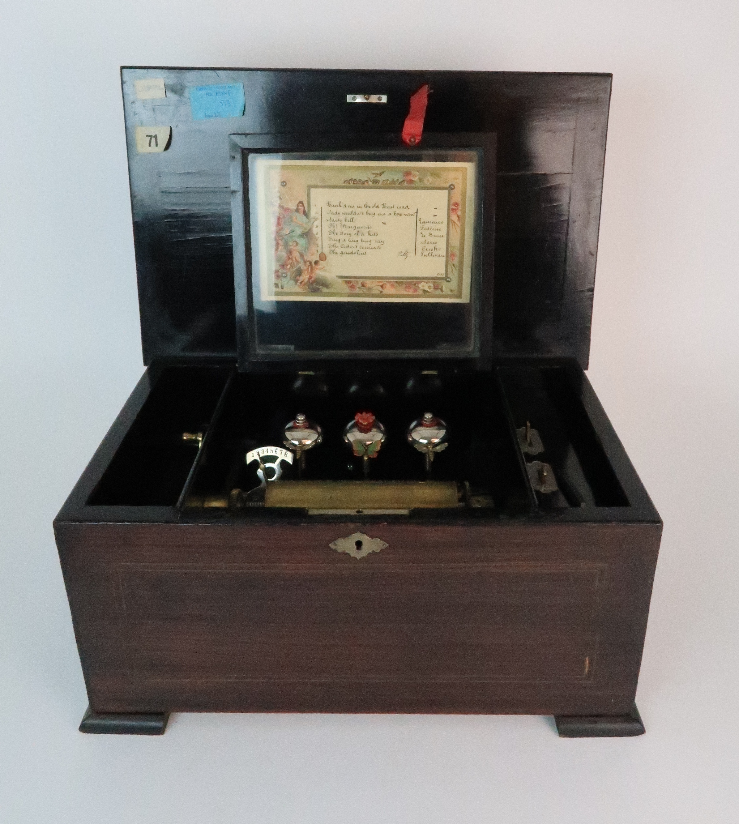 A LATE 19TH CENTURY INLAID MUSIC BOX with hinged lid, pinned list with three bells and butterfly