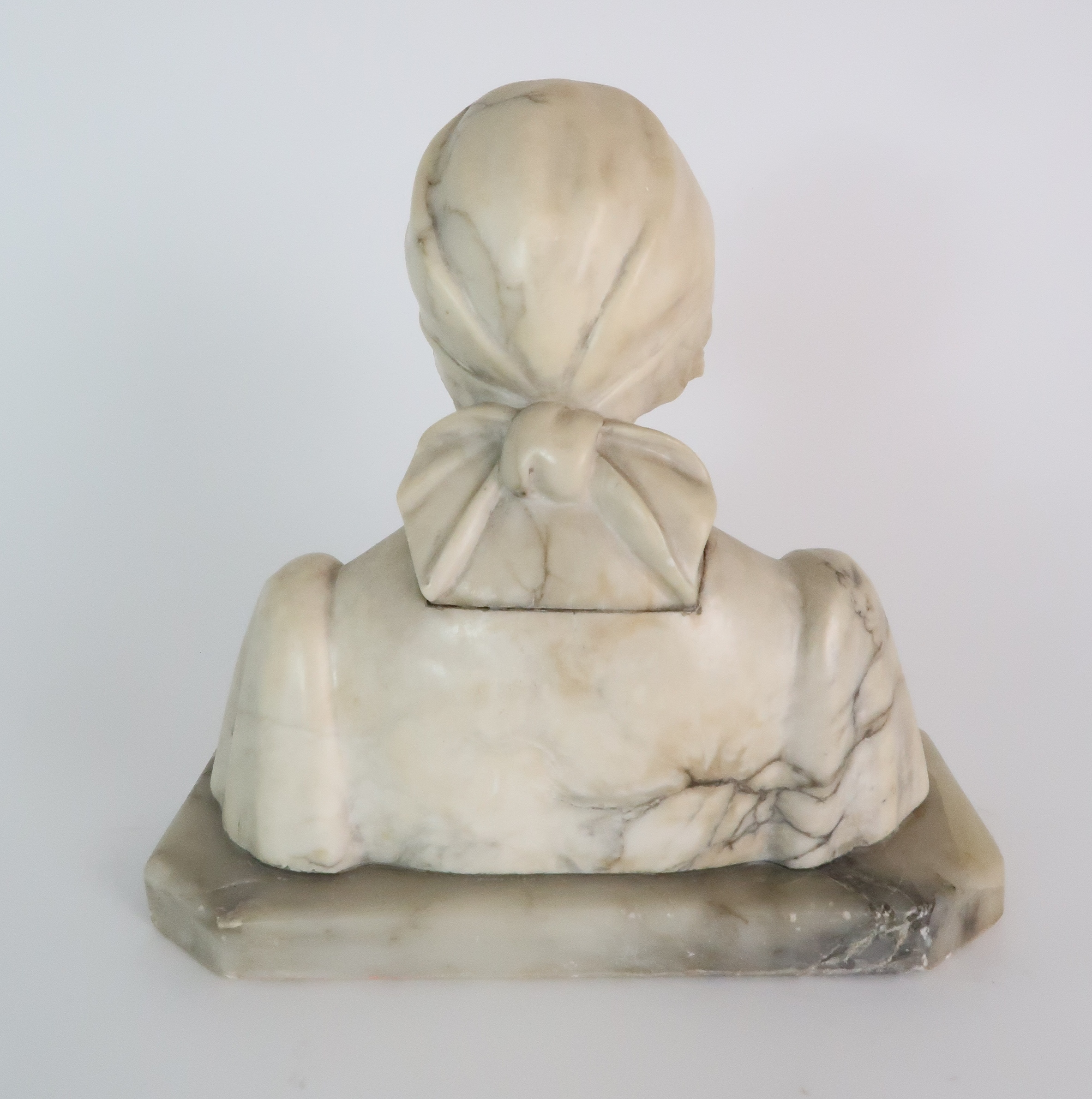 AN ALABASTER BUST OF A GIRL IN A HEAD SCARF upon shaped base, 25cm high Condition Report: - Image 3 of 5