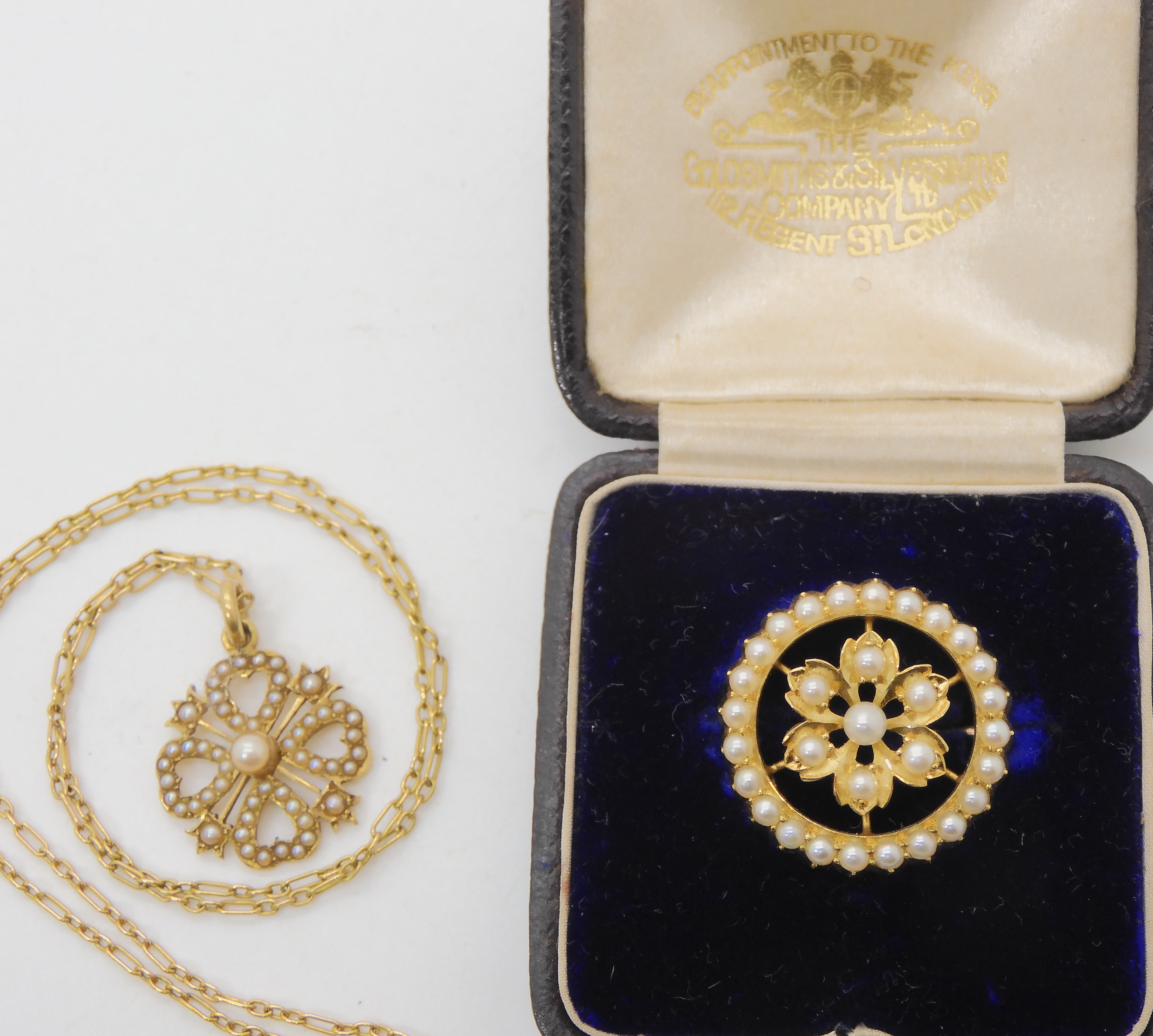 TWO VINTAGE PEARL SET ITEMS a brooch from the Goldsmiths & Silversmiths Co, in original fitted - Image 2 of 3