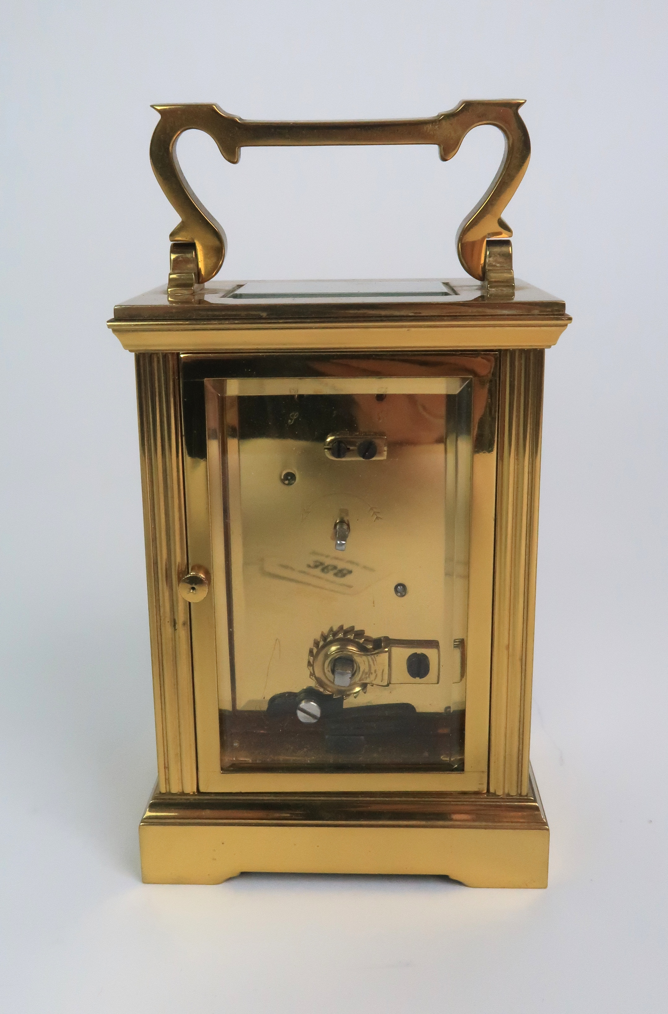 A GARRARD AND CO BRASS AND GLASS CARRIAGE CLOCK the white dial with Roman numerals and the - Image 3 of 6