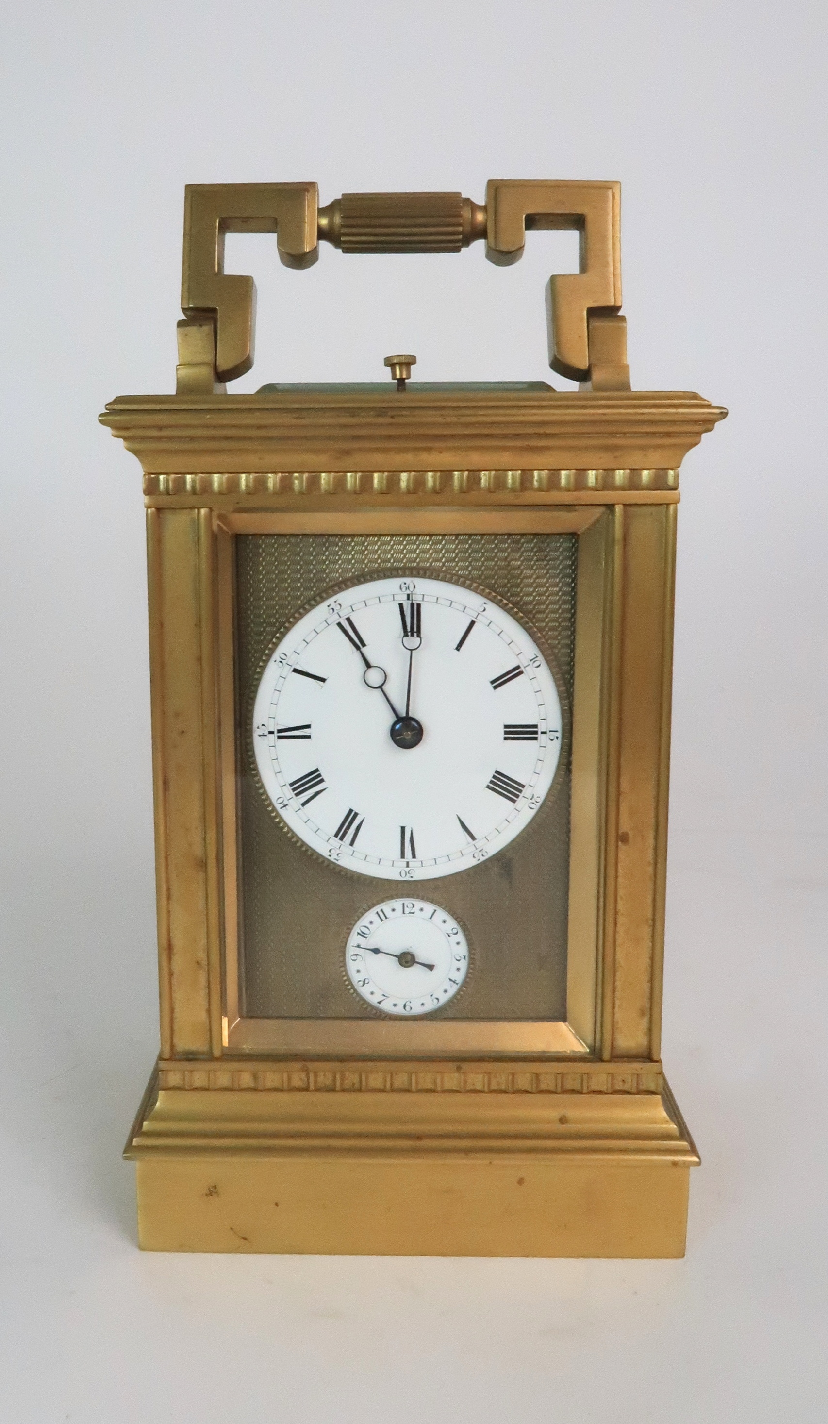 A FRENCH BRASS AND GLASS REPEATER CARRIAGE CLOCK the enamel dial with Roman numerals, with