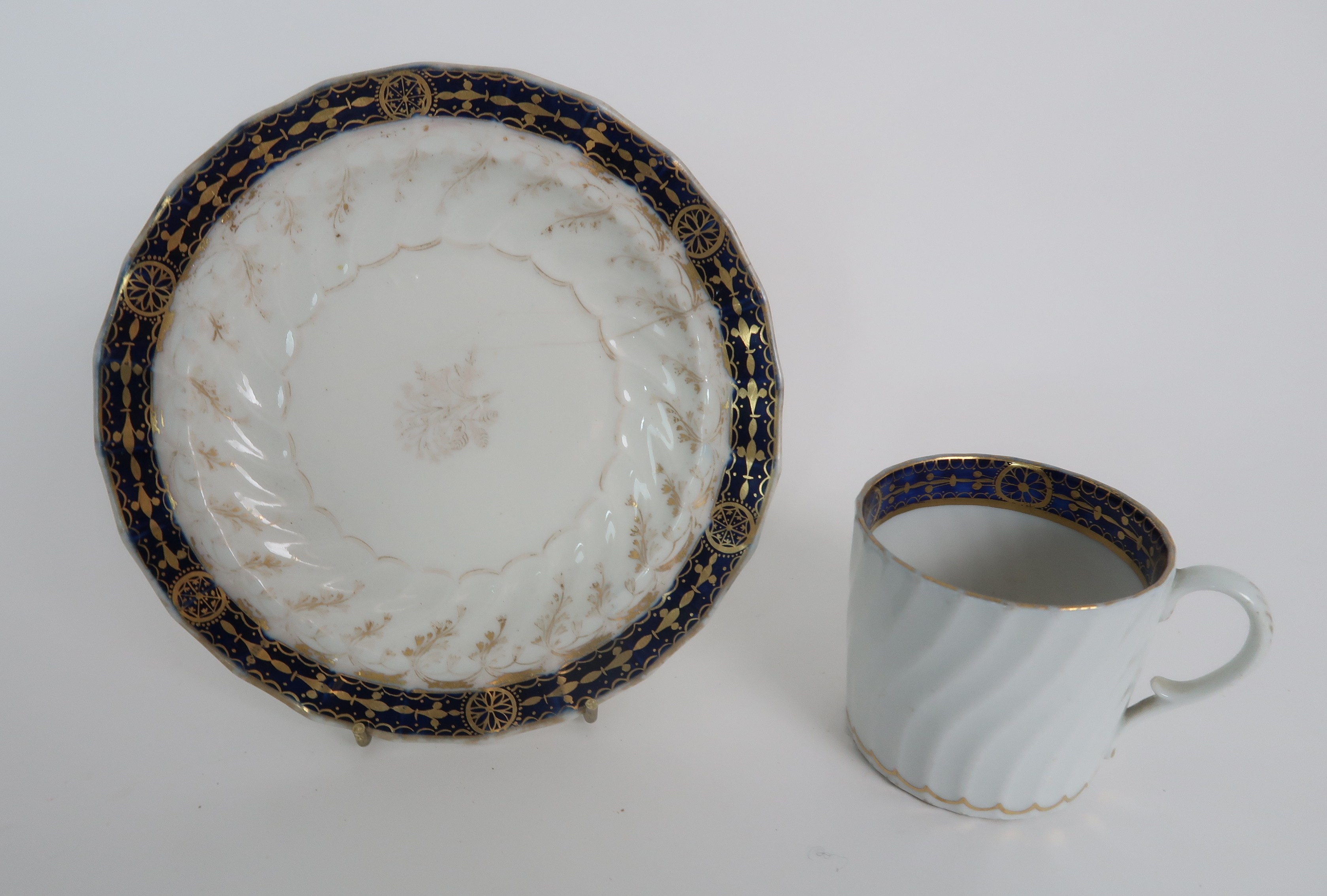 A COLLECTION OF 19TH CENTURY ENGLISH BLUE AND GILT DECORATED TEA AND COFFEE WARES including a - Image 15 of 23