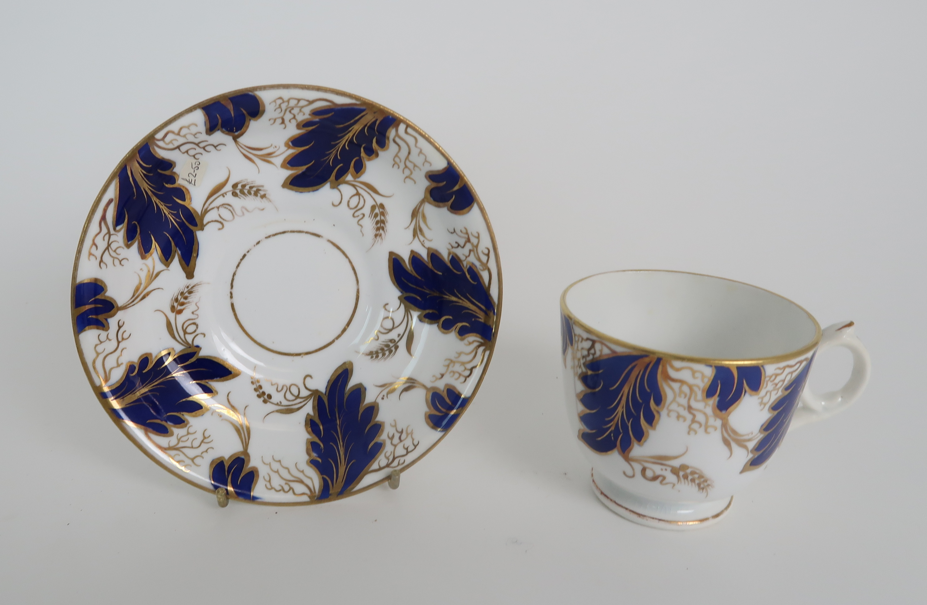 A COLLECTION OF 19TH CENTURY ENGLISH BLUE AND GILT DECORATED TEA AND COFFEE WARES including a - Image 16 of 23