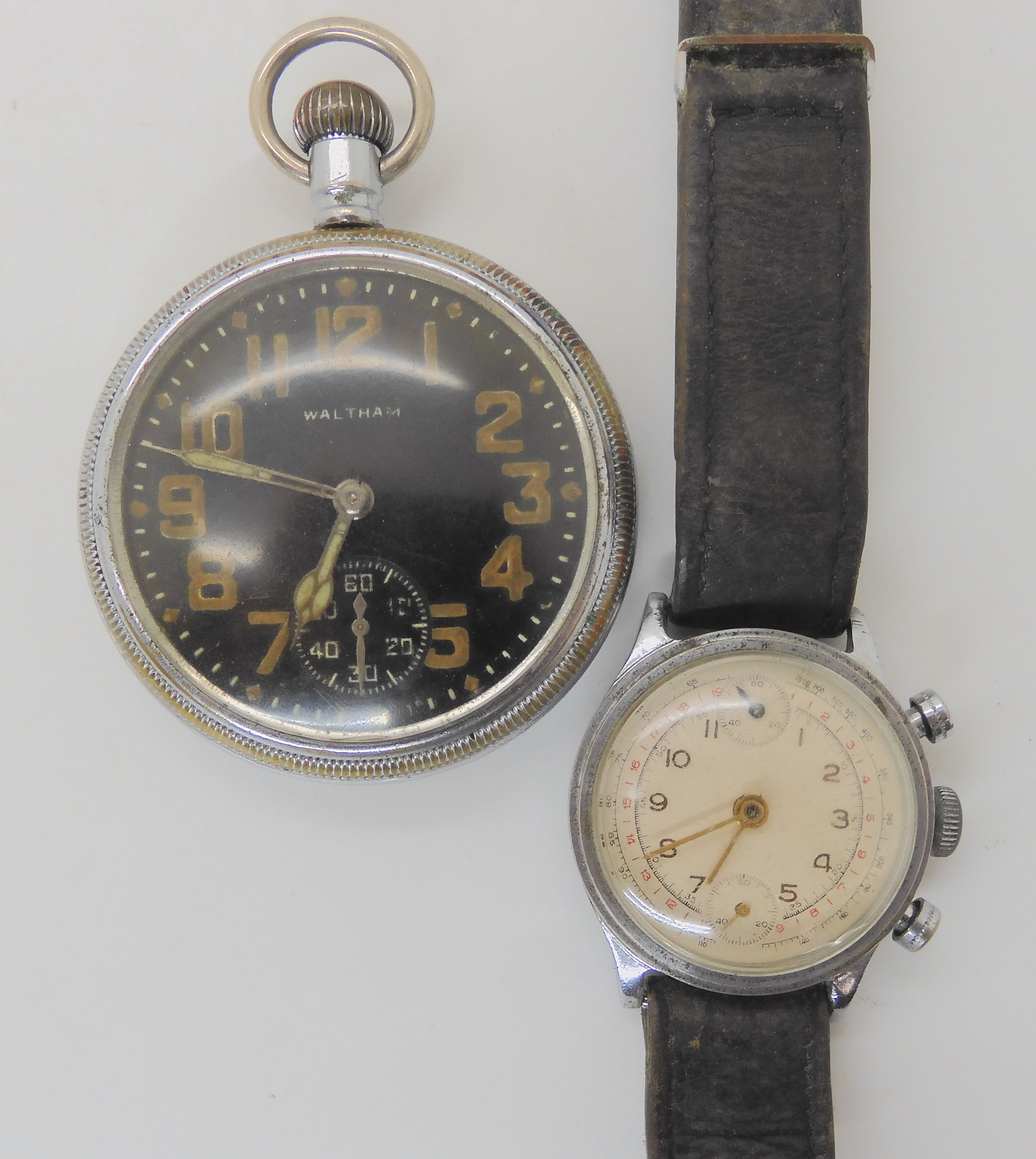 TWO MILITARY WATCHES a base metal Waltham pocket watch with a black dial subsidiary seconds dial and