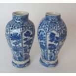 A PAIR OF CHINESE BLUE AND WHITE OCTAGONAL VASES each painted with panels of insects amongst foliage