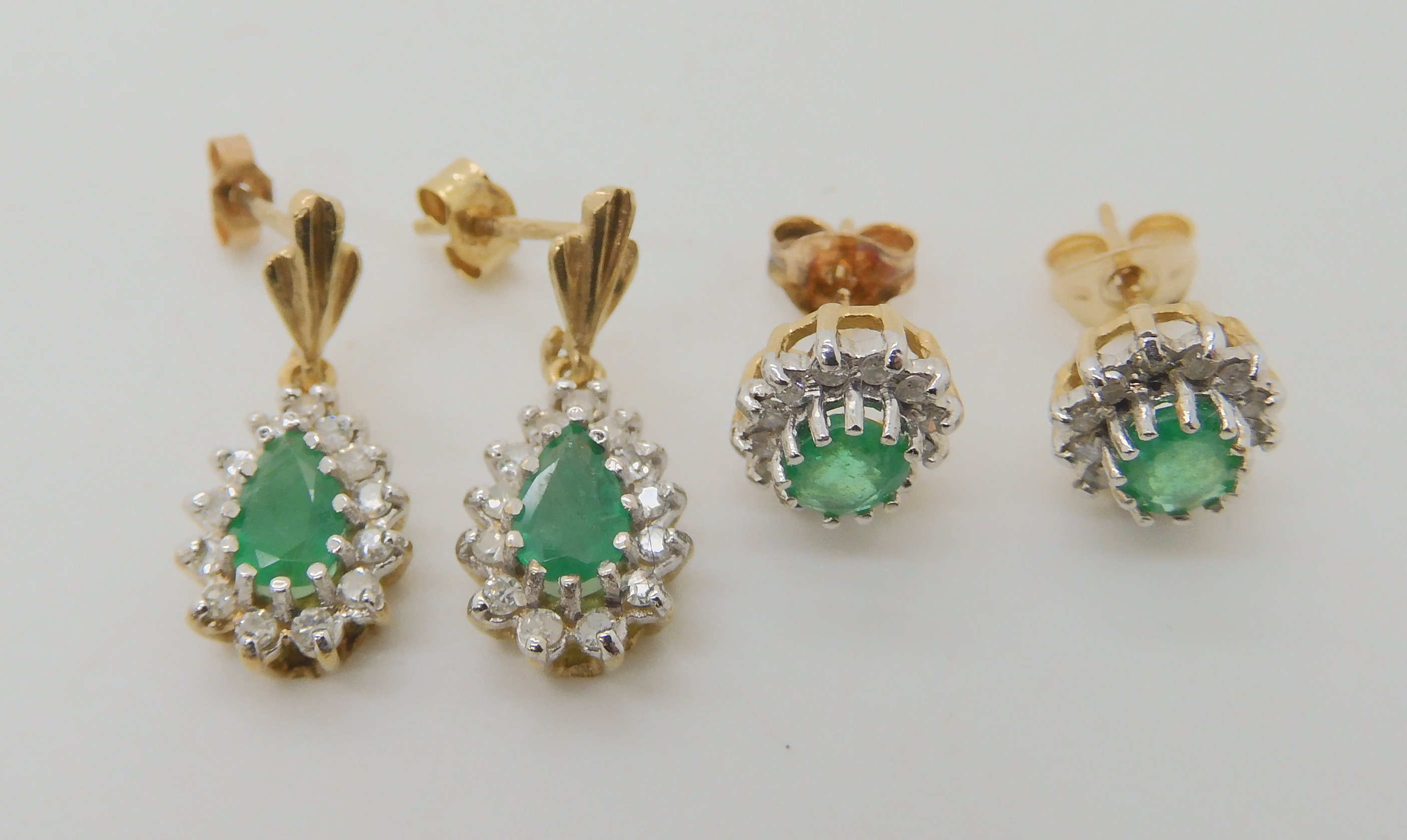 TWO PAIRS OF EMERALD AND DIAMOND EARRINGS pear shaped emerald and diamond drop earrings, set with