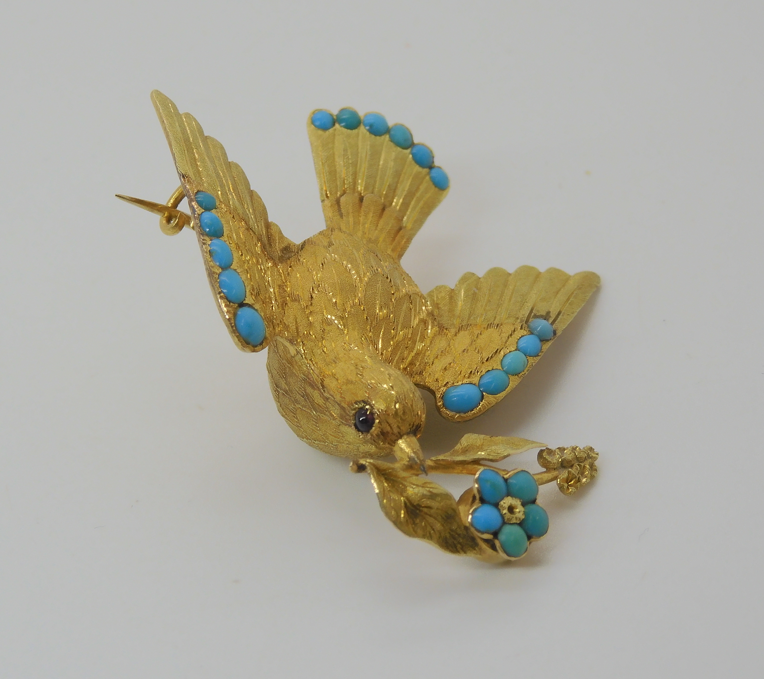 A VICTORIAN LOCKET BACK DOVE BROOCH SET WITH TURQUOISE craftsman made in yellow metal, with