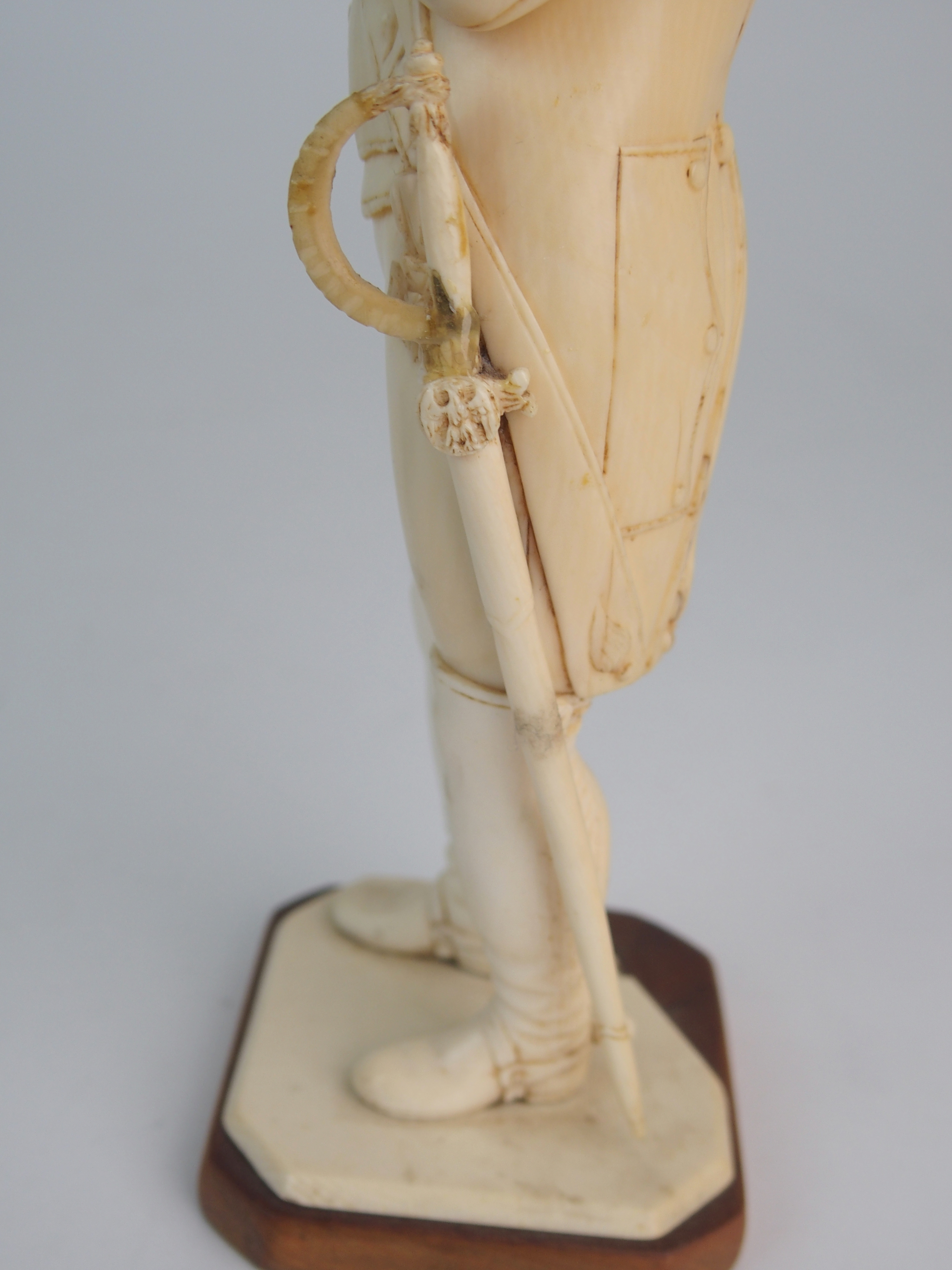 A LATE 19TH/EARLY 20TH CENTURY CARVED IVORY MODEL OF NAPOLEON in uniform with crossed arms, on - Image 5 of 9