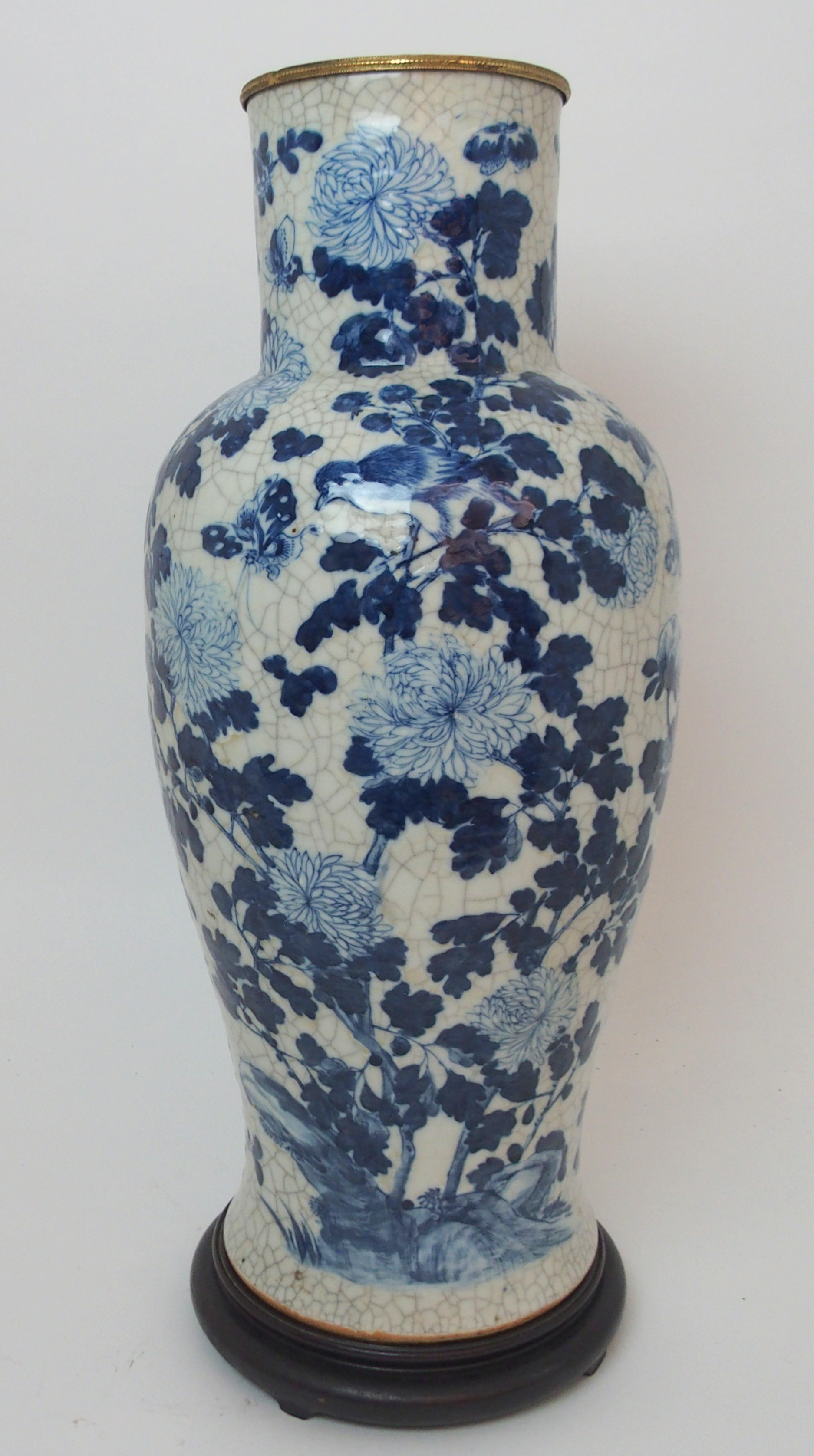 A LARGE CHINESE BLUE AND WHITE MOULDED VASE painted with birds and bats amongst peonies