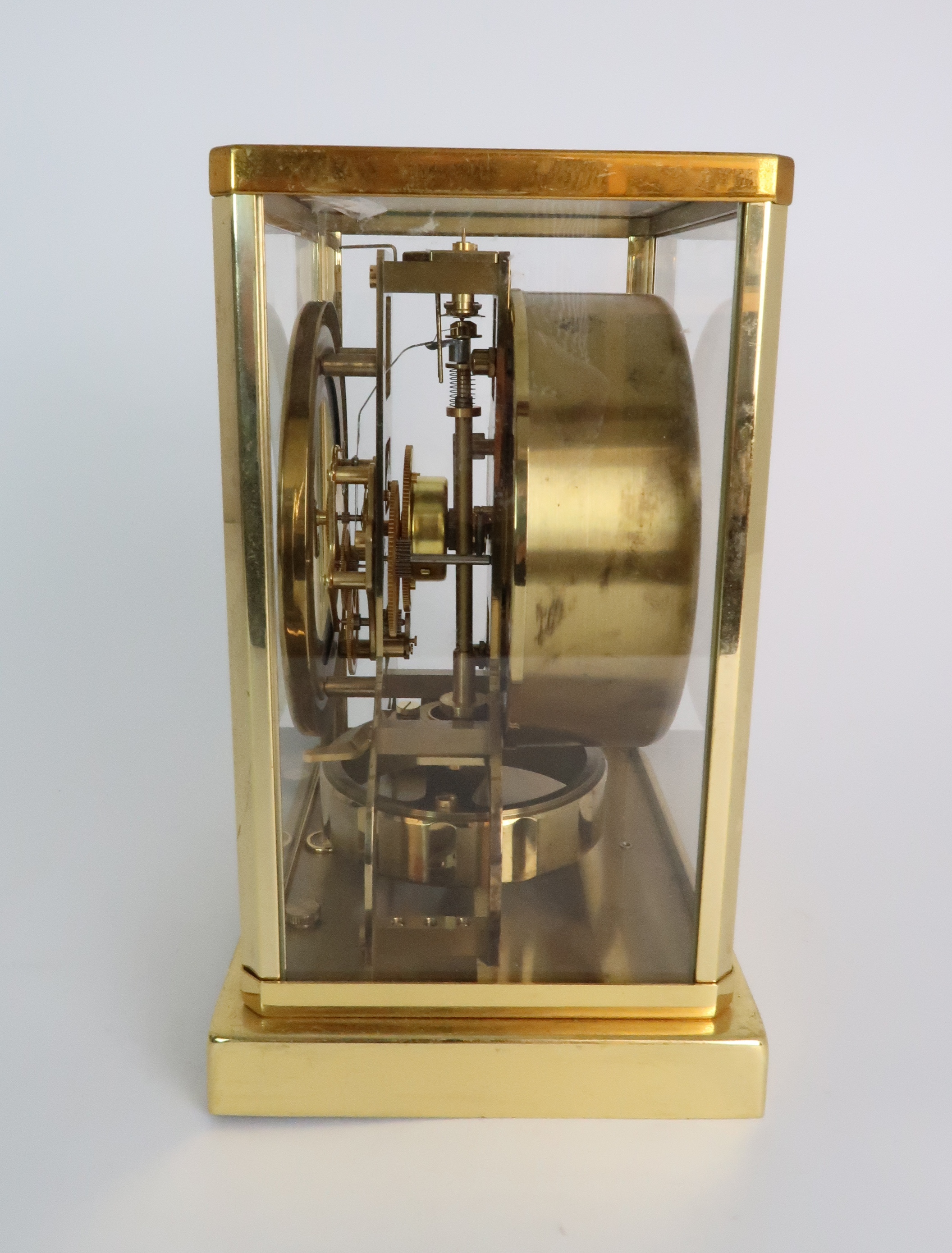 A JAEGER LE COULTRE ATMOS CLOCK in glazed brass case, the white enamel chapter ring with applied - Image 2 of 8