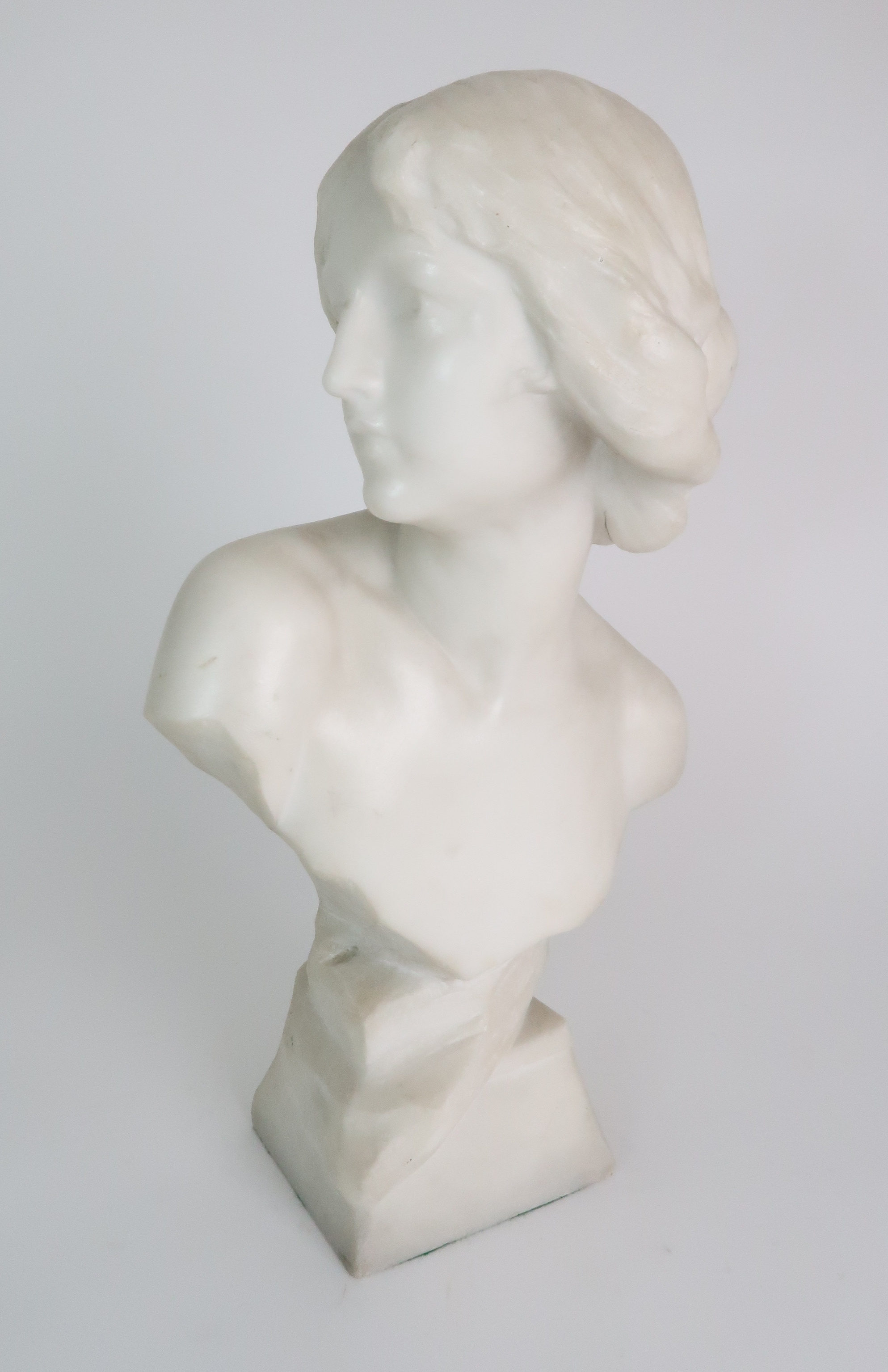 AN ALABASTER BUST OF A YOUNG WOMAN upon pedestal base, 39cm high Condition Report: Available upon