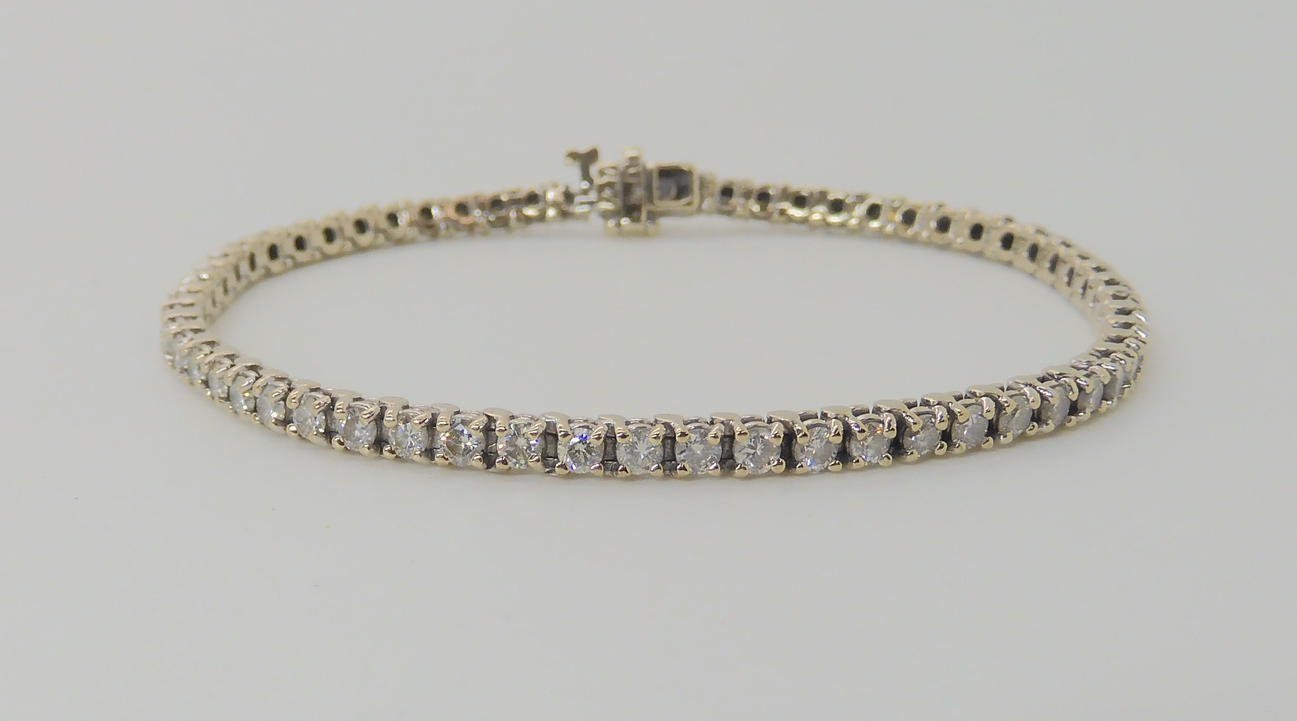 AN 18K WHITE GOLD DIAMOND LINE BRACELET set with estimated approx 2.7cts of brilliant cut - Image 3 of 5