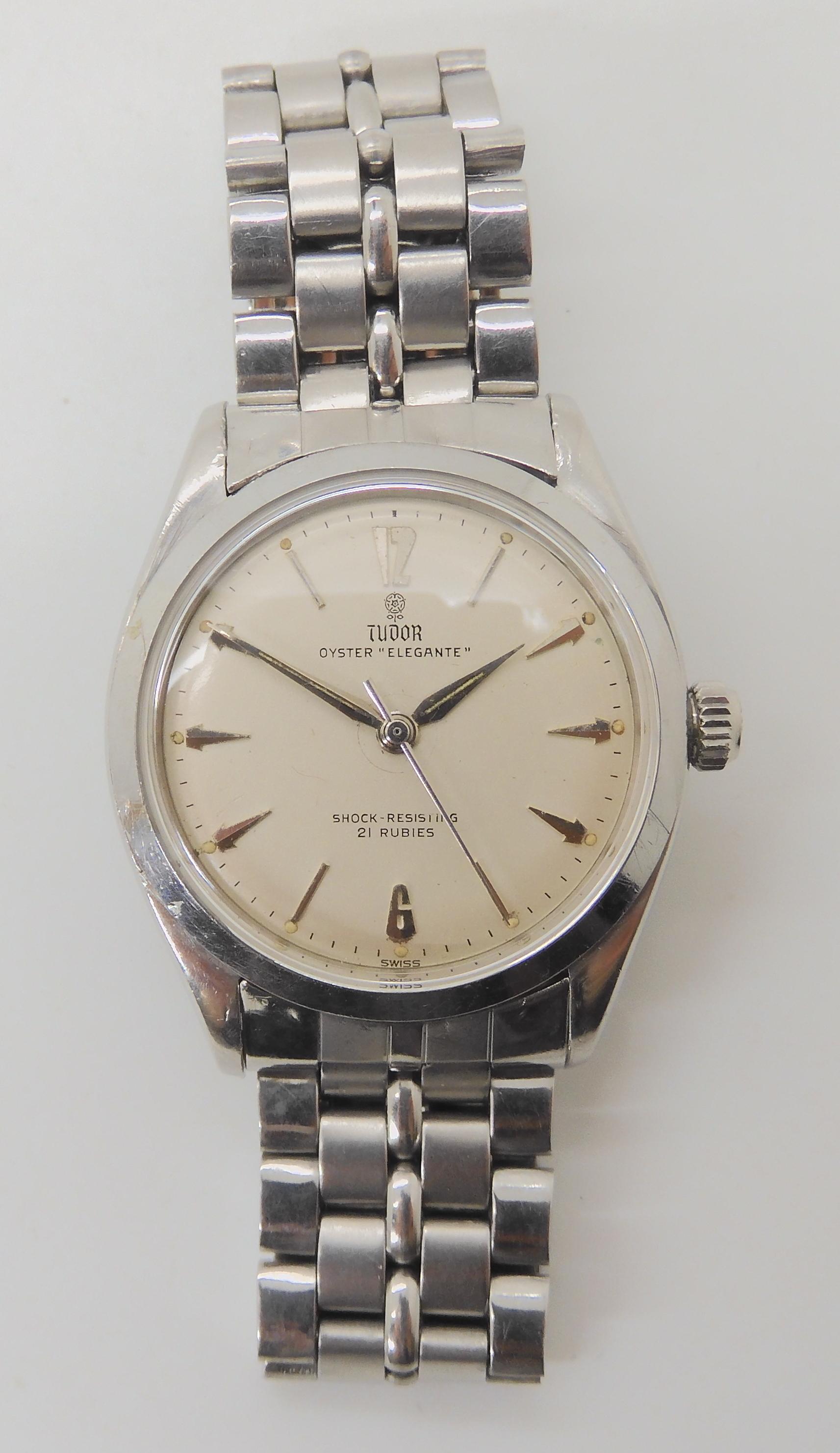 A GENTS TUDOR OYSTER ELEGANTE with cream dial, silver coloured baton, chevron and Arabic numerals,